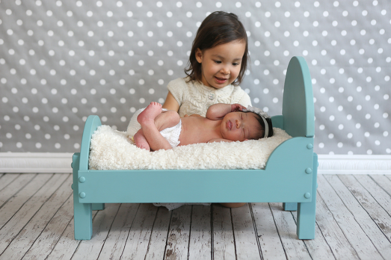 Newborn Baby In Doll Bed With Sister
