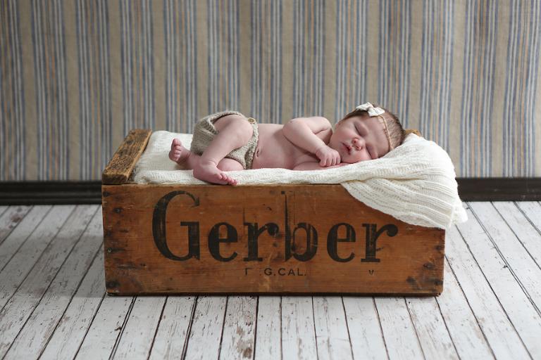 Newborn Baby In Gerber Crate