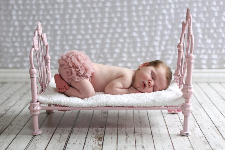 Newborn Baby On Iron Doll Bed