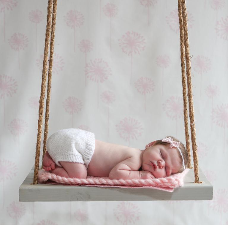 Newborn Baby On Swing